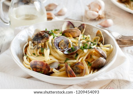 Linguini with clams top view - Traditional italian seafood pasta
