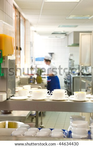 Lining up for a drink in the cafeteria - stock photo