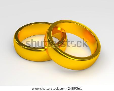 stock photo linked gold wedding rings on white background