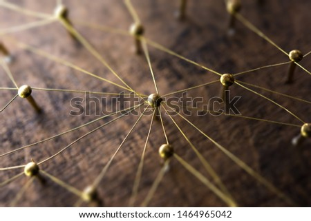 Linking entities. Network, networking, social media, internet communication abstract. Many small network connected to a larger network. Web of gold wires on rustic wood. . Shallow Depth of field. #1464965042