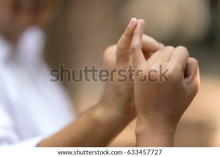 Linking little fingers with somebody to confirm promise.Hands posing together concept. #633457727