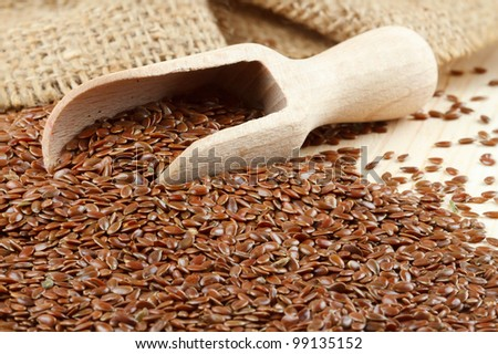 linseed, flax seeds, wooden scoop, sacking bag