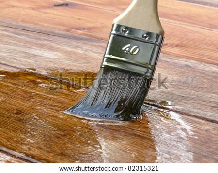 Linseed oil varnish paint on wood - stock photo