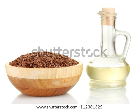 linseed oil with flax seeds isolated on white