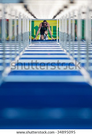 LINZ, AUSTRIA - AUGUST 2 Austrian track and field championship: Roland Schwarzl (#389) places second in the men's 110m hurdles event on August 2, 2009 in Linz, Austria.