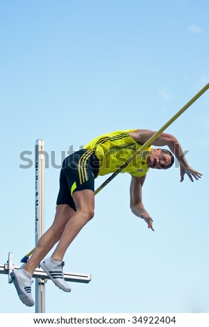 LINZ, AUSTRIA - AUGUST 1 : Roland Schwarzl (No. 389) wins in the men's pole vault event at Austrian track and field championship August 1, 2009 in Linz, Austria.