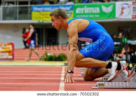 LINZ,  AUSTRIA - FEBRUARY 3: Linz indoor track and field meeting.  Florian Myerhofer (#98, Austria) takes part in the men's 60m sprint event on February 3, 2011 in Linz, Austria.