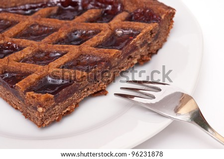 Linzer tarte with cake fork on a plate - stock photo