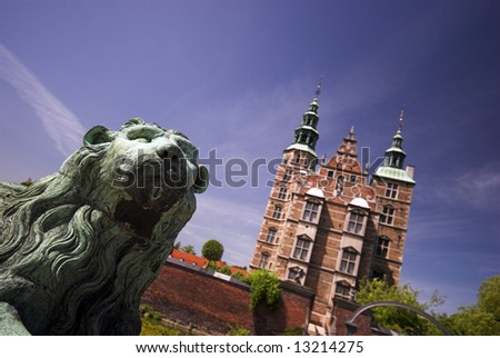Lion and Royal Rosenborg Castle in Copenhagen, Denmark – Danish Crown Jewels are kept here. The castle was originally built as a country summerhouse – Year 1606.