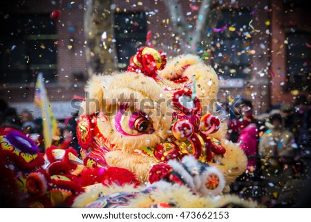 Lion dance and confetti during Chinese New Year celebration