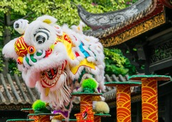 lion dance performing in a traditional Chinese pavilion