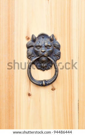 lion door knob on wood