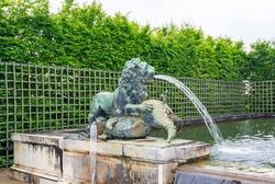 Lion fountain in Versailles gardens, Paris, France