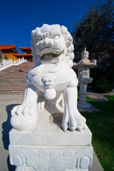 Lion guarding entrance to a Buddhist temple in Wollongong NSW Australia
