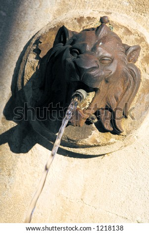 Lion head fountain in Aix-en-Provence, France - Angled