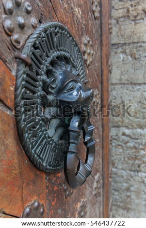 Lion Head Knocker, Ancient Knocker bronze handles on old oak door stock photo #546437722