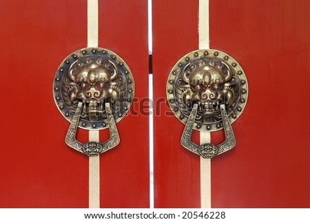 Lion knocker on red door