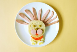 lion made of bread, eggs and sausage. funny idea of dish for Kids. food art. creative breakfast. restaurant menu. snack time. beautiful dinner.