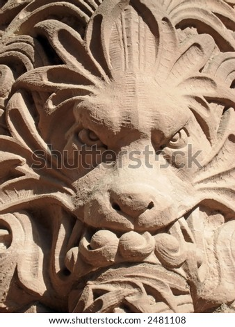 Lion on the side of the Parliament buildings, Queens Park, Toronto, Ontario, Canada.