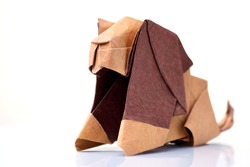 Lion origami miniature on white. Cute sculpture of animal, made of colored paper. Japanese art of folding paper.