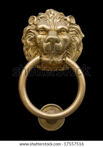 Lion's head door knocker isolated on black