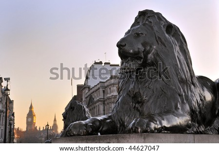 Lion sculpture at Nelson's Column Memorial, Trafalgar Square, London, England. With Big Ben in the background.