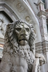 lion sculpture on the street of italian city Florence