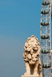 Lion statue and Millennium Wheel, London