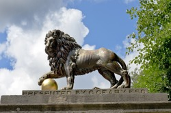 lion statue on Royal Avenue (copies of the late 16th century Italian Medici lions in Florence) in Bath, Somerset, England