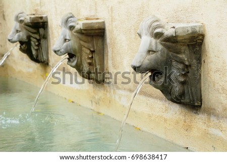 lion statue spitting water...