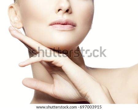 Lips and hand of model girl. Nude make-up, perfect skin. Skincare health concept #697003915
