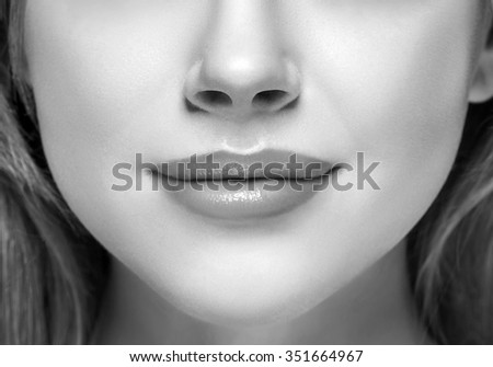 Lips and nose Woman happy young beautiful studio portrait black and white