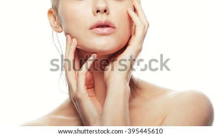 Lips and shoulders of young caucasian woman with natural make-up, perfect skin isolated on white. Studio portrait. Toned #395445610