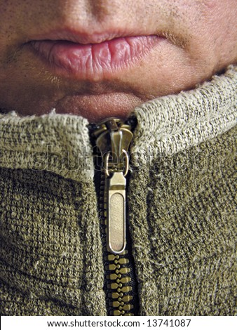 lips at top of zipped sweater