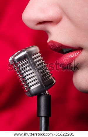 Lips girl and a miniature microphone in glamour style