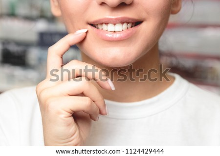 Lips Protection. Closeup of Beautiful Young Woman Healthy Lips. Female Model Mouth With Smooth Perfect Skin Touching Her Plush Lips #1124429444
