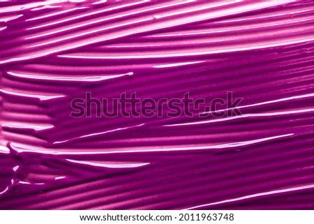 Lipstick balm vinous pink purple smudge texture background Foto d'archivio ©