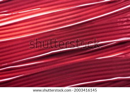 Lipstick balm vinous pink smudge texture background Foto d'archivio ©
