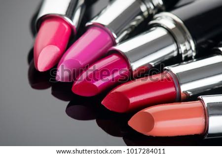 Lipstick. Fashion Colorful Lipsticks over black background. Lipstick tints palette, Professional Makeup and Beauty. Beautiful Make-up concept. Lipgloss. Lipsticks closeup - Shutterstock ID 1017284011