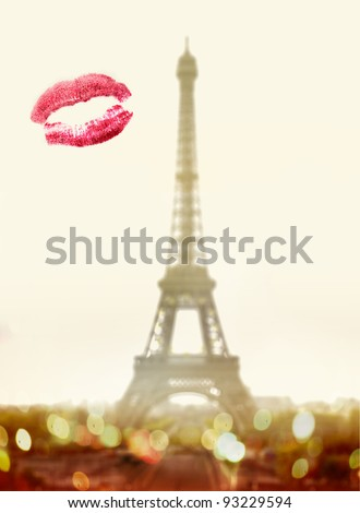Lipstick kiss on window in front of famous Eiffel Tower in Paris