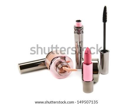 lipstick mascara and cream powder on a white background