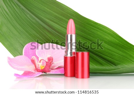 lipstick on green leaf isolated on white