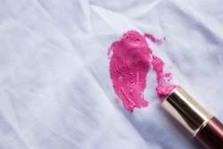 Lipstick stain on white shirt from old expire lipsticked of beauty cosmetic using