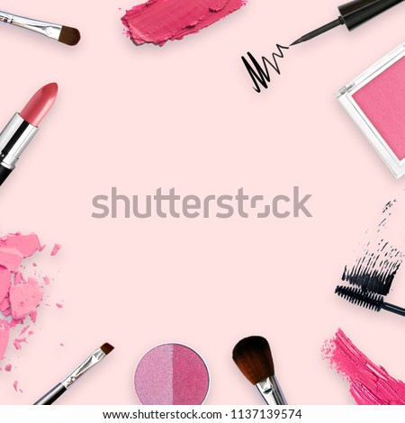 lipstick, tools, eyeliner, blush on, eye shadow and powder cosmetic in pink theme make up on frame for promotion