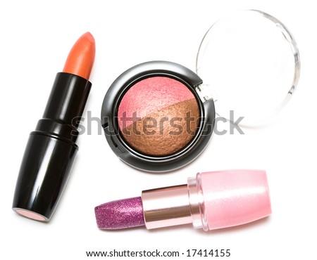 Lipsticks and eye-shadows isolated on white background