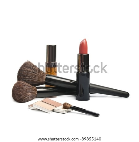 Lipsticks and eye-shadows isolated on white background