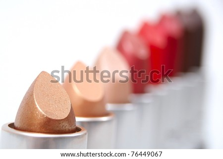 Lipsticks in straight line isolated on white background