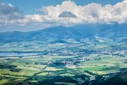 Liptov basin and Liptovsky Mikulas from Sina peak, Low Tatras mountains, Slovak republic. Hiking theme. Seasonal natural scene.