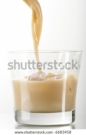 liqueur in glass on the white background