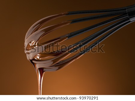 liquid chocolate topping on a whisk